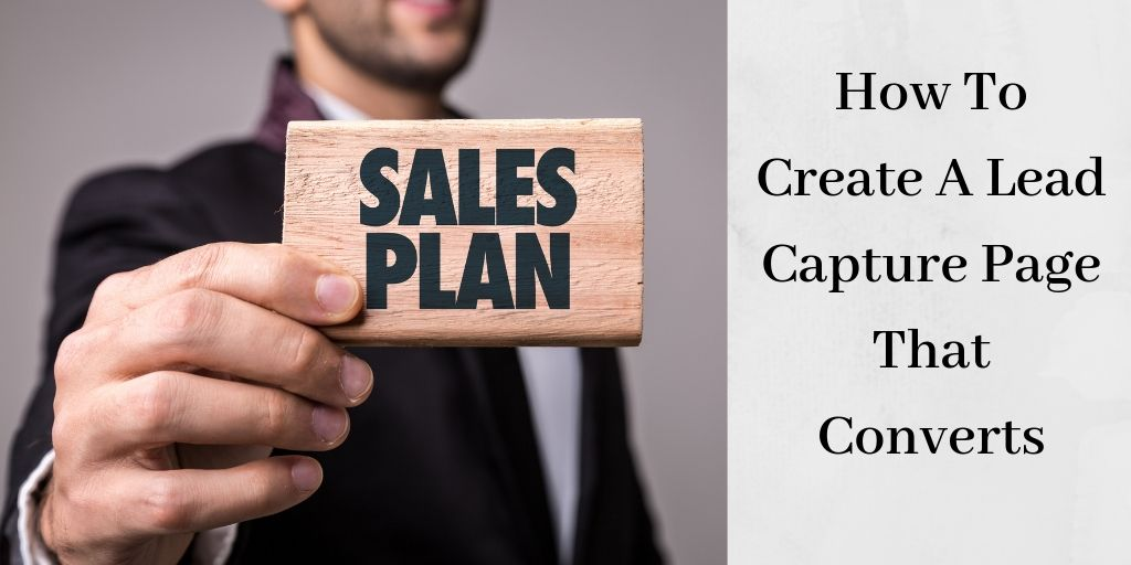 """man holding sign that says """"Sales Plan"""""""