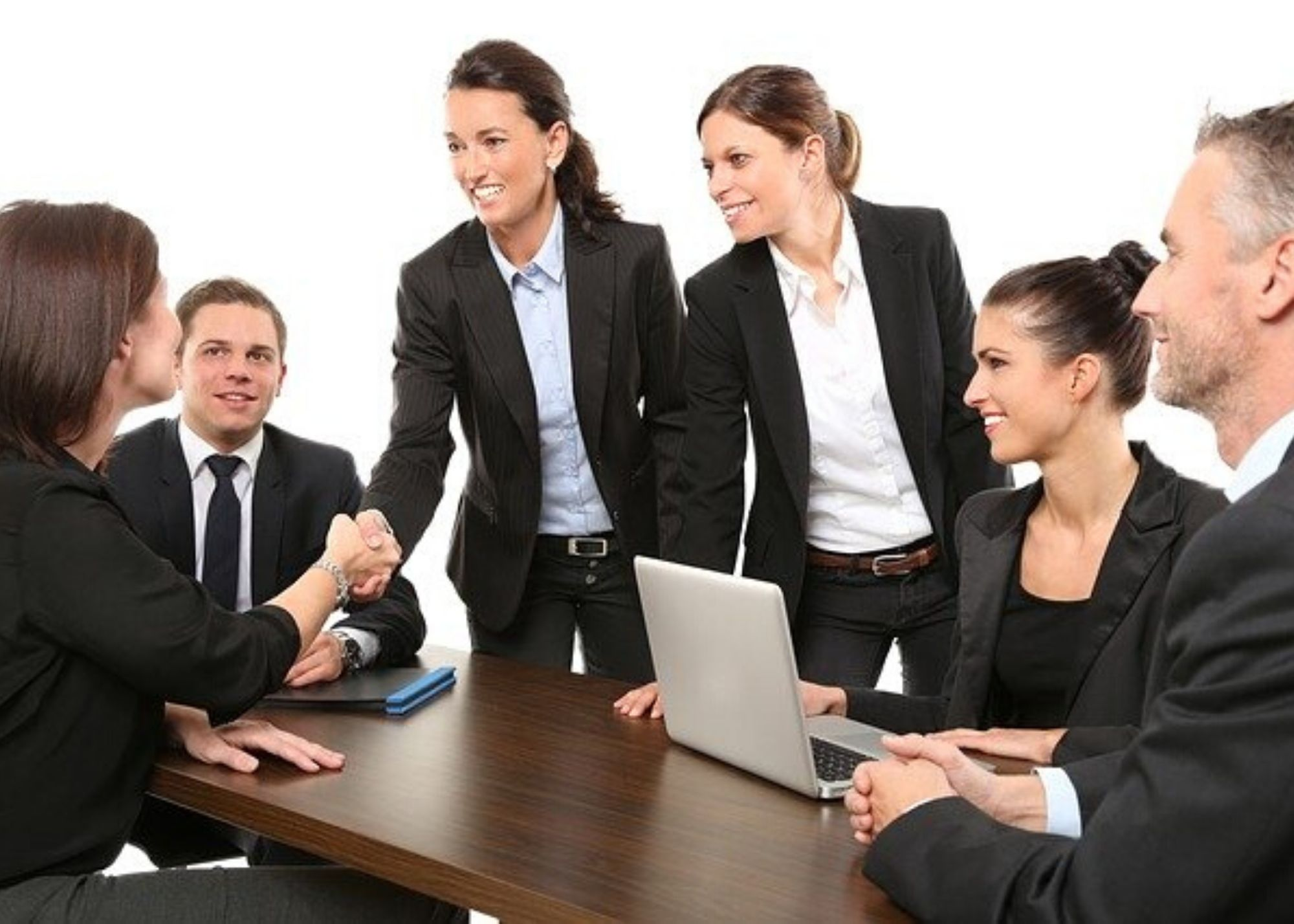 5 Ways To Make A Great First Impression - Employees Shaking Hands
